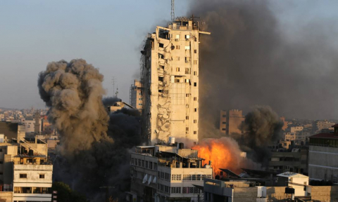x92859155_Smoke-and-flames-rise-from-a-tower-building-as-it-is-destroyed-by-Israeli-air-strikes-amid.jpg.pagespeed.ic.hHHZng82x7.jpg